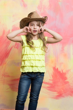 cowboy hat on adorable girl wearing american outfit Stock Photo