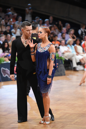 Stuttgart, Germany - August 14, 2015: An unidentified dance latin couple in a dance pose during Grand Slam Latin at German Open Championship, on August 14, in Stuttgart, Germany Editorial