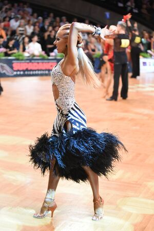 world championships: Stuttgart, Germany - August 14, 2015: An unidentified latin female dancer in a dance pose during Grand Slam Latin at German Open Championship, on August 14, in Stuttgart, Germany Editorial