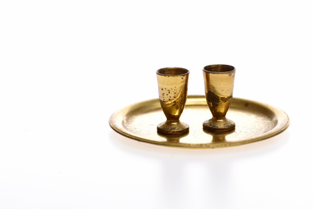goblets on golden tray isolated on white background. Antique concept, copy space