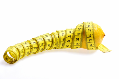 Diet concept. Tape-measure twined around lemon isolated on white background, copy space