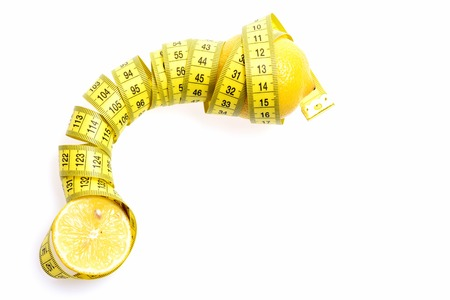 Health and diet concept. Tape-measure twined around lemon isolated on white background, copy space