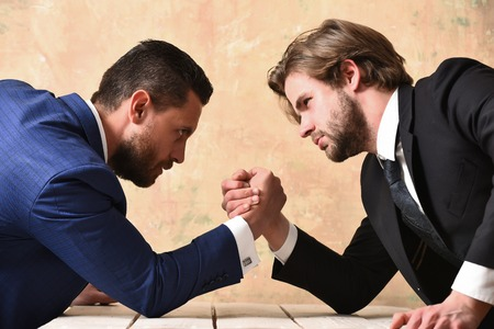partnership and teamwork, arm wrestling of businessman and compete man, co workers and dominance Imagens