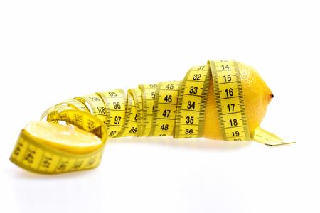 Centimeter twined around lemon isolated on white background