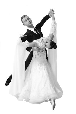 ballroom dance couple in a dance pose isolated on white background. sensual professional dancers dancing walz, tango, slowfox and quickstep. Black and white Stock Photo
