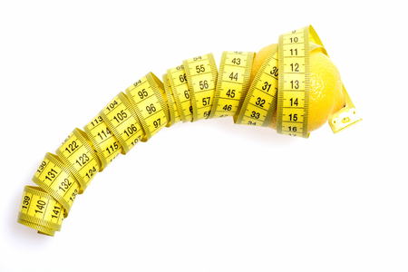 tape-measure twined around lemon isolated on white background, copy space Stock Photo