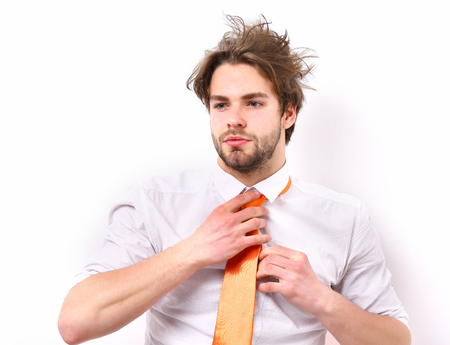 Bearded man, short beard. Caucasian serious macho with moustache and ruffled hair have acid orange tie on white shirt isolated on white studio background, office worker concept Stock Photo