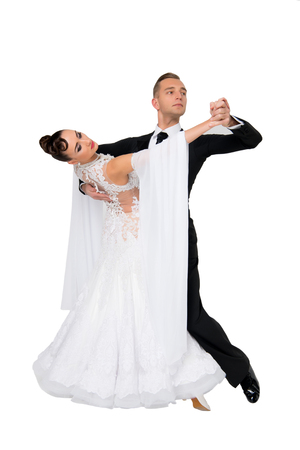 dance ballroom couple in a dance pose isolated on white background. sensual professional dancers dancing walz, tango, slowfox and quickstep.