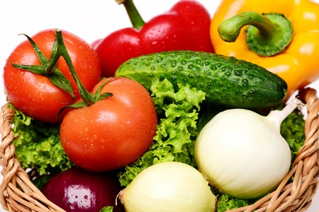 close up of onions in a basket: organic food concept, vegetables or green lettuce leaf, tomatoes with onions, peppers, cucumber in basket isolated on white background, close up