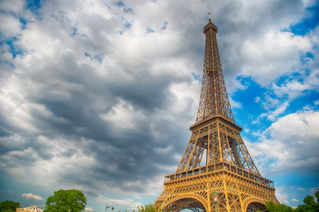 Eiffel Tower at sunset in Paris, France. Romantic travel background. HDR. Eiffel tower is traditional symbol of paris and love.
