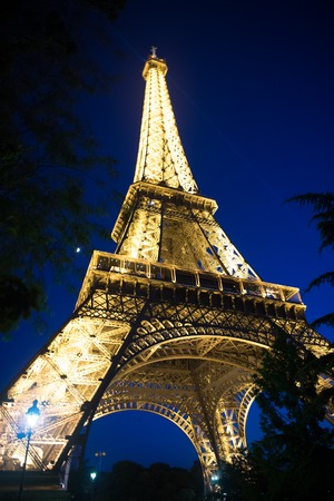 Paris, France-June 1, 2016 : Eiffel Tower with illumination at night in Paris, France. Romantic travel background. Eiffel tower is traditional symbol of paris and love. Editorial