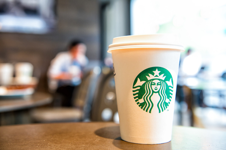 Berlin, Germany-May 31.2017: A tall Starbucks coffee in starbucks coffee shop. Starbucks is the worlds largest coffee house with over 20,000 stores in 61 countries. Editorial