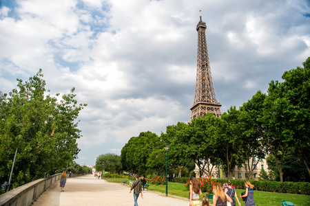 Paris, France-June 1. 2017 :Eiffel Tower at sunset in Paris, France. Romantic travel background. Eiffel tower is traditional symbol of paris and love.