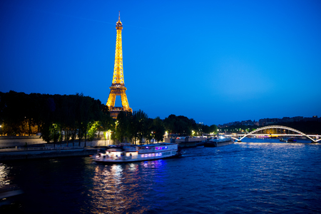 Paris, France-June 1, 2016 : Eiffel Tower with illumination at night in Paris, France. Romantic travel background. Eiffel tower is traditional symbol of paris and love. Stock Photo