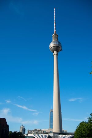 mauer: view of Berlin skyline with famous TV tower at Alexanderplatz and dramatic cloudscape, Germany. Berlin Stock Photo