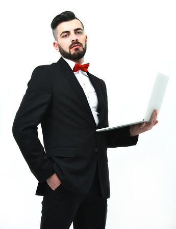hair stylist: Confident businessman or head manager with beard holds white laptop, isolated on white background. Concept of business technology and success Stock Photo