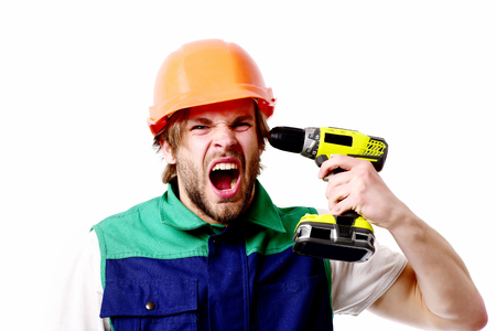 Work in progress, repairing and fun concept. Construction worker screams and holds yellow drill near ear. Builder in orange helmet and uniform. Man with face showing pain, isolated on white background 版權商用圖片