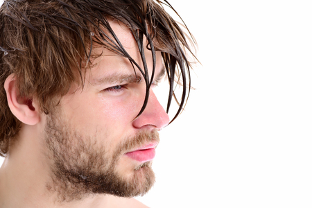 Macho with fair beard, serious face and short hair. Guy with messy wet fringe looks aside isolated on white background, copy space. Shower time concept