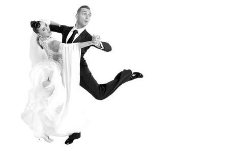 dance ballroom couple in a dance pose isolated on white background. sensual professional dancers dancing walz, tango, slowfox and quickstep. black and white