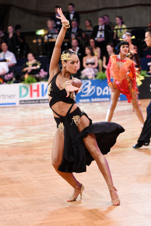 14: Stuttgart, Germany - August 14, 2015: An unidentified latin female dancer in a dance pose during Grand Slam Latin at German Open Championship, on August 14, in Stuttgart, Germany Editorial