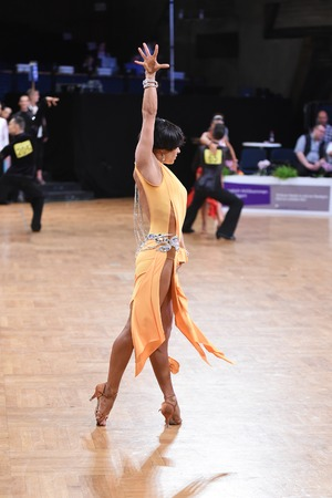 Stuttgart, Germany - August 14, 2015: An unidentified latin female dancer in a dance pose during Grand Slam Latin at German Open Championship, on August 14, in Stuttgart, Germany 報道画像