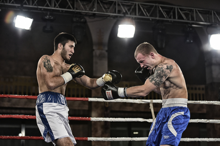 olympic ring: Kyiv, Ukraine - December 24, 2016: An unidentified boxers in the ring during fight for ranking points in the NSC Olimpiyskiy, Kyiv, Ukraine