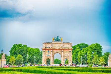 Paris, France-June 1, 2016 : Triumphal Arch (Arc de Triomphe du Carrousel) at Tuileries gardens in Paris, France. Monument was built between 1806-1808 to commemorate Napoleons military victories.