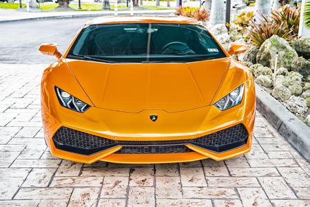 shiny car: Miami, Florida, USA-February 19, 2016: Supercar Lamborghini Aventador orange color parked next to Ocean drive at South bech at Miami, Florida. Lamborghini car is famous expensive automobile brand car Editorial
