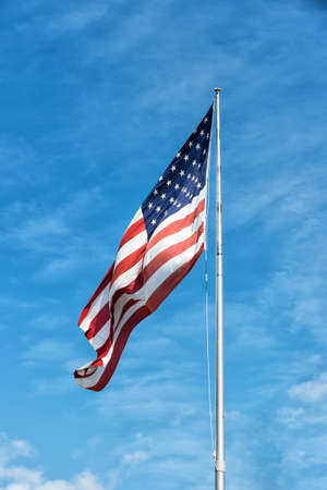American flag against blue sky at summer day Stock Photo
