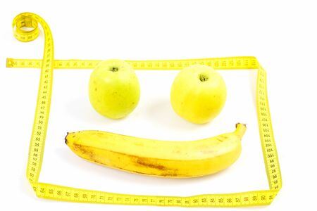 Banana And Two Green Apples Makes Happy Face With Measuring Tape ...