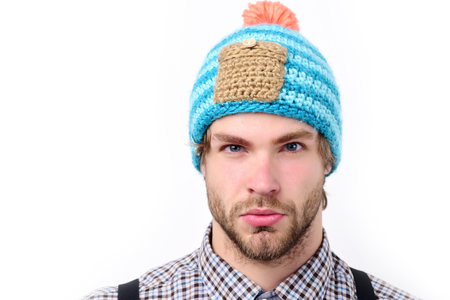 Bearded man with confident face in hat. Man in winter hat and plaid shirt isolated on white background. Guy with stylish hat in blue, beige and orange color. Winter and casual style clothes concept Stock Photo