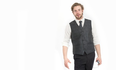 man with beard in formal outfit listen music on mp3 or mobile phone isolated on white, copy space Stock Photo