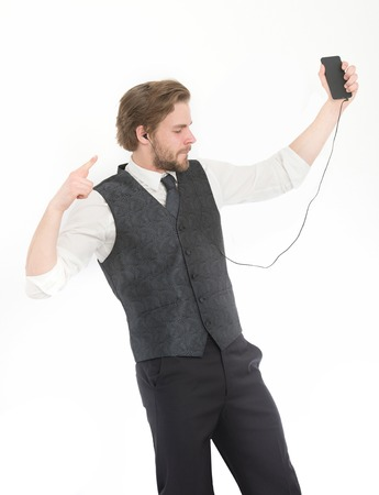 Businessman or ceo listen music. Man in formal outfit with mobile phone. Headset and mp3. Manager with beard on inspired face. Fashion and new technology.