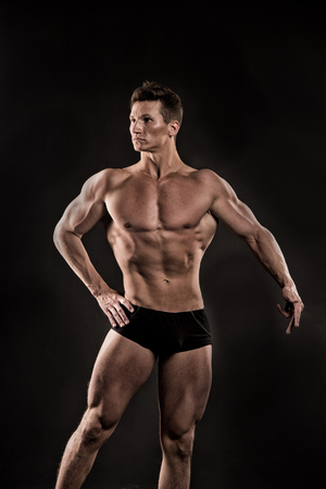 Athletic Bodybuilder Pose In Pants. Man With Muscular Body. Sport ...