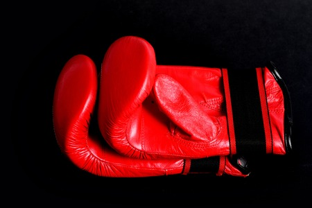 Pair of red boxing gloves for heavyweight category fight isolated on black background. Concept of professional gym training set Stock Photo