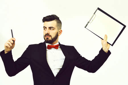 Busy director in classic suit and red bow tie holding expensive pen and clip folder with copy space. Serious and overwrought, isolated on white background