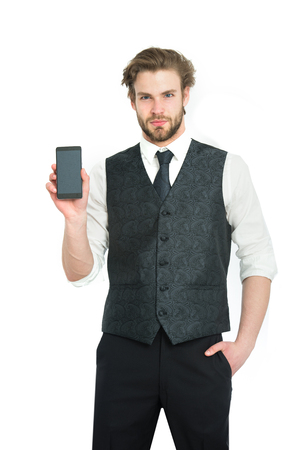 marketing online: Guy presenting product of smartphone. Man with mobile or cell phone. Businessman with phone in outfit isolated on white background. Business and communication. Buy online and digital marketing. Stock Photo