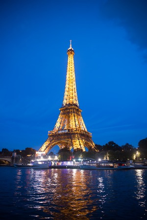 Paris, France-september 23, 2017 : Eiffel Tower with illumination at night in Paris, France. Romantic travel background. Eiffel tower is traditional symbol of paris and love.