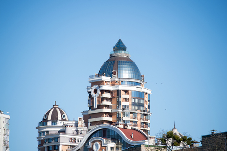 residential construction: Top of high building on sunny day on blue sky background in Kyiv, Ukraine. Architecture, construction, art and designing concept. Stock Photo