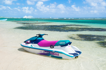 Costa Maya, Mexico - February 01, 2016: watercraft yamaha on clear sea or ocean water with white sand on sunny day on cloudy blue sky. Recreation, sport, activity. Summer vacation, travelling concept.