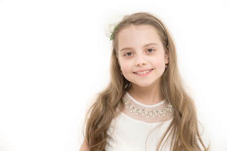 Girl with smile on cute face isolated on white. Innocence, purity concept.