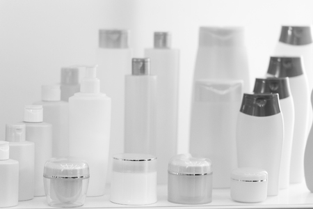 Composition with containers of body care and beauty products. Eco cosmetics. pink colors
