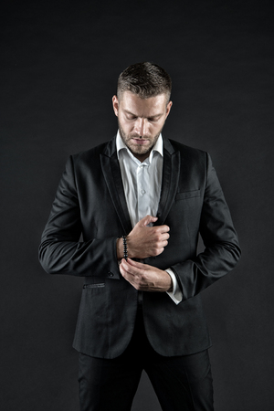 Man in formal outfit on black background. Businessman or ceo fashion. Manager with beard on confident face. Business and success. Modern life and agile business