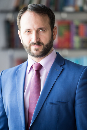 Career, profession, work. Man with beard in blue jacket, shirt and tie. Fashion, style, dress code. Businessman or director pose in office. Business, entrepreneurship concept. Banque d'images
