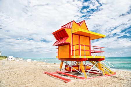 South Beach, Miami, Florida. lifeguard house in a colorful Art Deco style on cloudy blue sky at Miami South Beach and Atlantic Ocean in background, world famous travel location