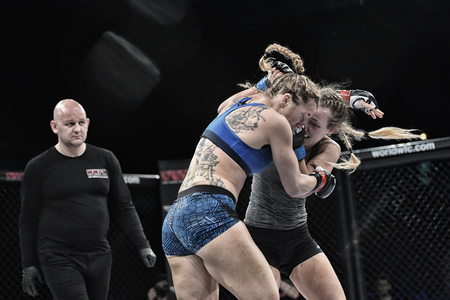 Kyiv, Ukraine -March 13, 2017: mma female fighters fight at the ring fight at the championship in Palace of sport in Kiev, Ukraine powerfuf girls or women fighters fight for mma champions belt
