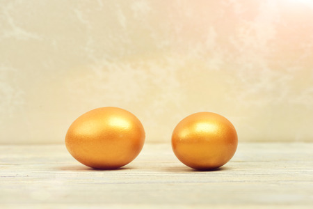 happy easter egg. holiday bunny and eggs, spring flower backround happy easter concept, traditional eggs painted in golden metallic color on grey background, luxury and success, birth and future life