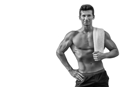 Athlete with strong arms, biceps and triceps. Sportsman smiling with towel on white background. Fitness and sport. Man with bare torso with six pack and ab. Hygiene and health concept, copy space