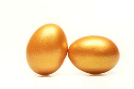 funny easter egg traditional eggs painted in golden color isolated on white background. Happy Easter concept, luxury and success Standard-Bild - 96108943