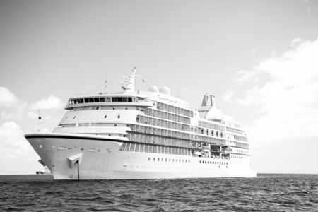 cruise ship. Large luxury white cruise ship liner on sea water and cloudy sky background